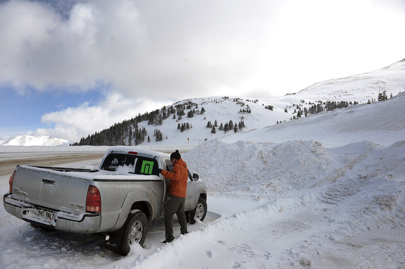 . Mike Bennet, a friend of the avalanche victims, checks out the car that was left behind on Loveland Pass after the avalanche on Sunday, April 21, 2013. The deadly avalanche occurred on the western flank of Mount Sniktau in an area known as Sheep Creek off of Loveland Pass.  It killed 5 snowboarders.  (Photo By Helen H. Richardson/ The Denver Post)