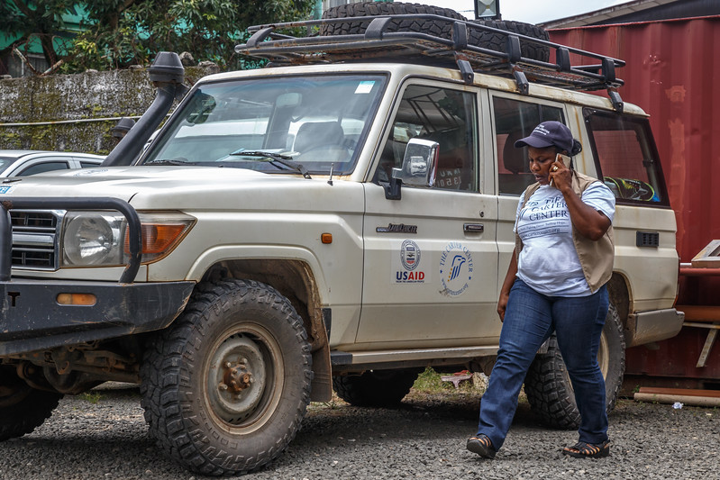 Monrovia, Liberia October 13, 2017 - Rosetta Quoime, driver for TCC and one of a few professional women drivers in Liberia, with a vehicle she drives.