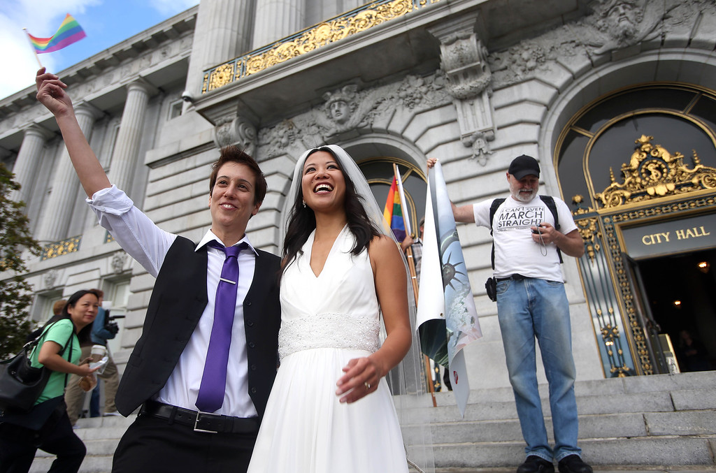 . Lisa Dazols, left, and her partner of five years Jenni Chang, of San Francisco, celebrate the Supreme Court\'s decision on Proposition 8 and the Defense of Marriage Act after a screening at City Hall in San Francisco, Calif., on Wednesday, June 26, 2013. The U.S. Supreme Court dismissed California\'s Proposition 8 and declared the 1996 Defense of Marriage Act unconstitutional. (Jane Tyska/Bay Area News Group)