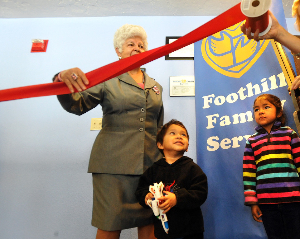 . Jay, 3, and Yvonne Solorio, 6, help Congresswoman Grace Napolitano with the ribbon cutting at Foothill Family Service�s new El Monte South Family Center on Tuesday April 2, 2013. The family center provides mental health and social services for children and families in the greater El Monte area, including Early Head Start and school-based mental health services at local schools. (SGVN/Staff Photo by Keith Durflinger)