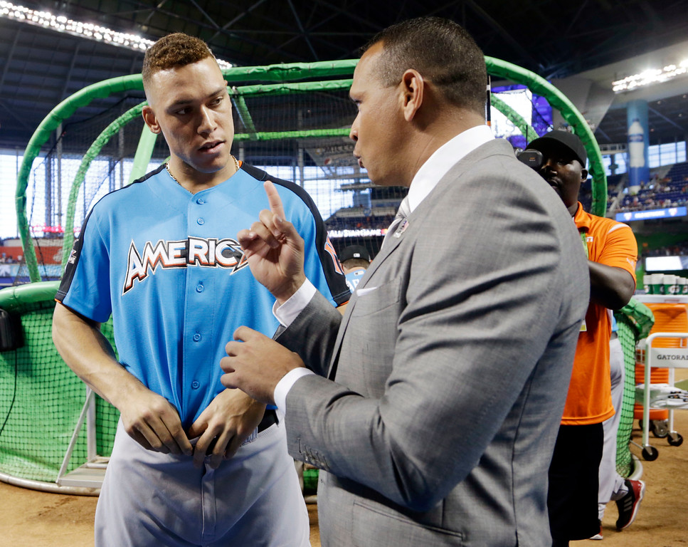 . American League\'s New York Yankees Aaron Judge (99), left, listens to former player Alex Rodriguez, prior to the MLB baseball All-Star Game, Tuesday, July 11, 2017, in Miami. (AP Photo/Lynne Sladky)