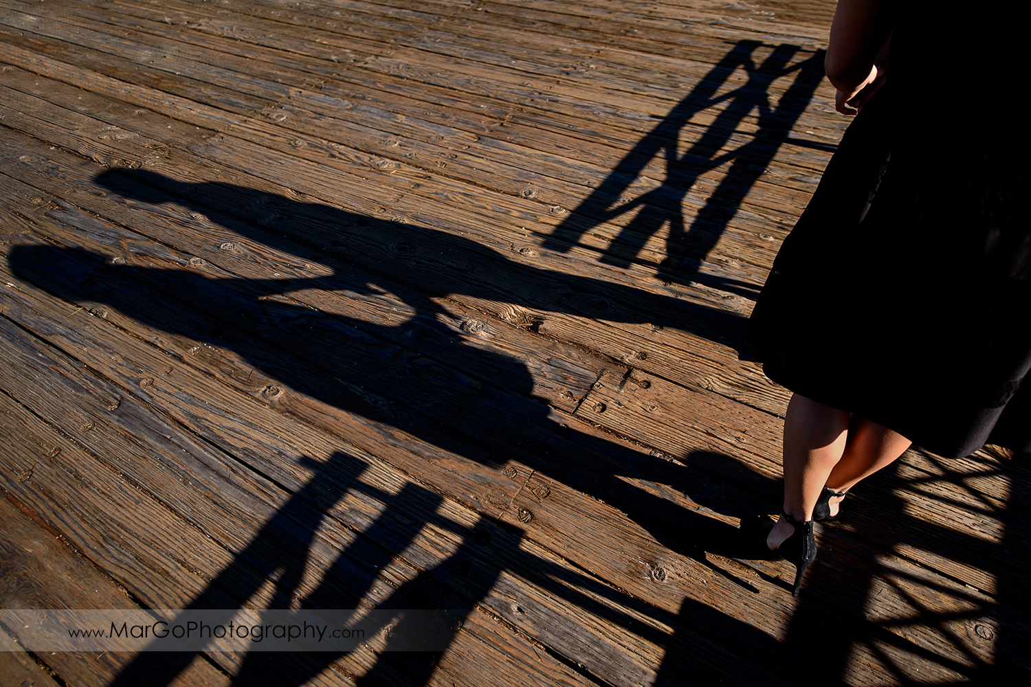 engagement session at Pier 7 in San Francisco - shadows of the couple