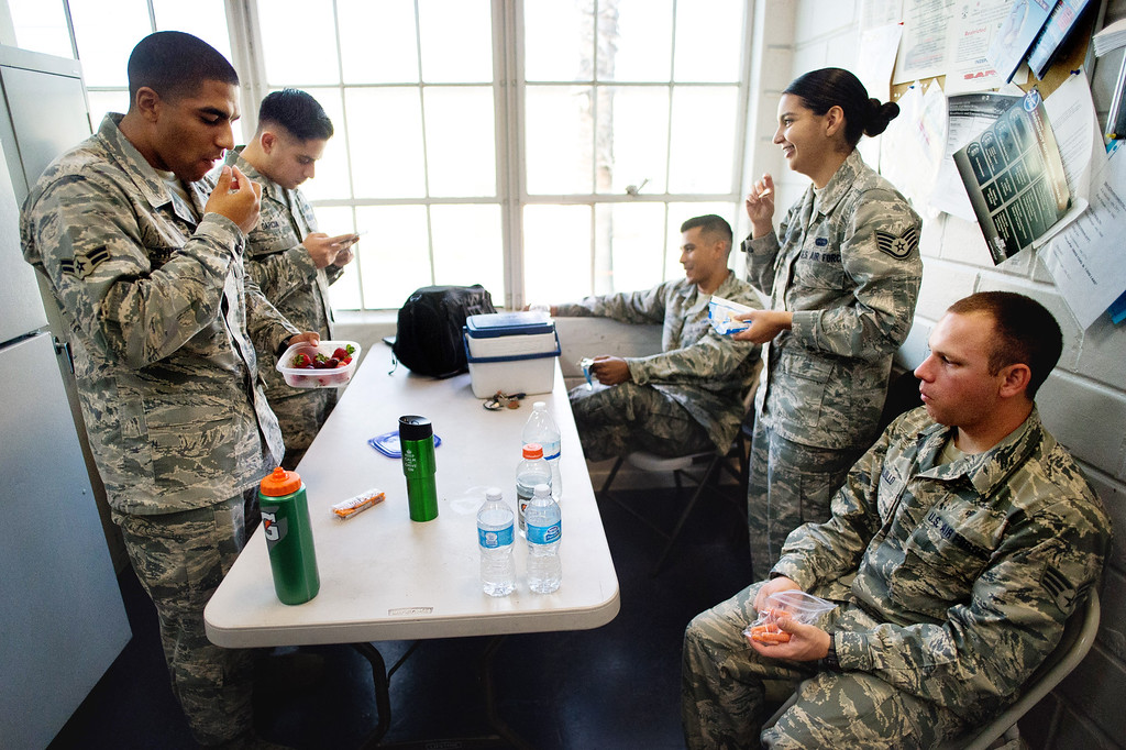 . Members of the Blue Eagles Honor Guard take a break from training practice at March Air Reserve Base in Riverside, Calif. on Tuesday, May 12, 2015. (Photo by Watchara Phomicinda/ Los Angeles Daily News)