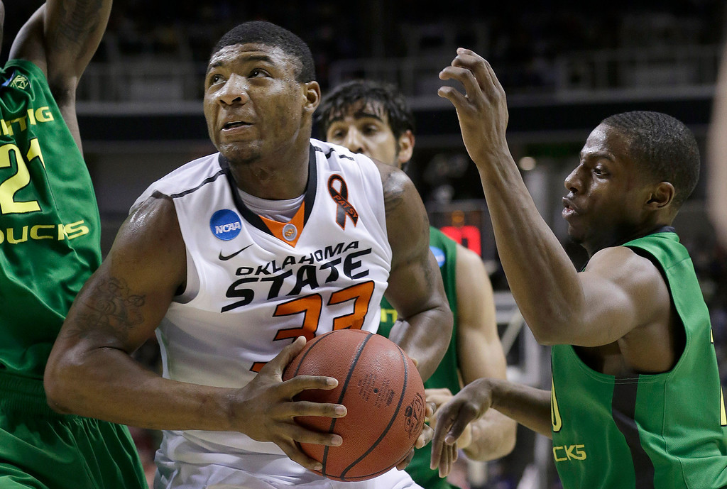 . Oklahoma State guard Marcus Smart (33) shoots against Oregon guard Johnathan Loyd during the first half of a second-round game in the NCAA college basketball tournament in San Jose, Calif., Thursday, March 21, 2013. (AP Photo/Jeff Chiu)