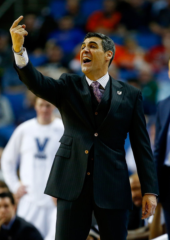 . BUFFALO, NY - MARCH 20: Head coach Jay Wright of the Villanova Wildcats motions to his players during the second round of the 2014 NCAA Men\'s Basketball Tournament against the Milwaukee Panthers at the First Niagara Center on March 20, 2014 in Buffalo, New York.  (Photo by Jared Wickerham/Getty Images)