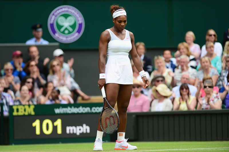 . Serena Williams of United States of America looks dejected during her Ladies\' Singles fourth round match against Sabine Lisicki of Germany on day seven of the Wimbledon Lawn Tennis Championships at the All England Lawn Tennis and Croquet Club on July 1, 2013 in London, England.  (Photo by Mike Hewitt/Getty Images)