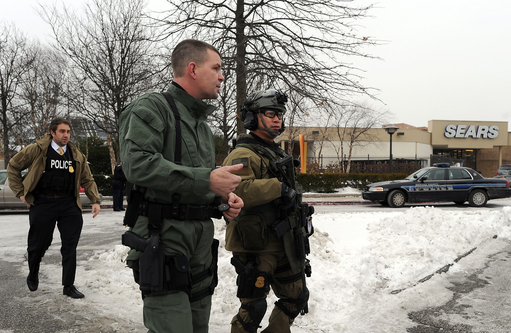 . Emergency responders arrive at the Columbia Mall after a fatal shooting on January 25, 2014, in Columbia, Maryland. AFP PHOTO/Jewel  SAMAD/AFP/Getty Images