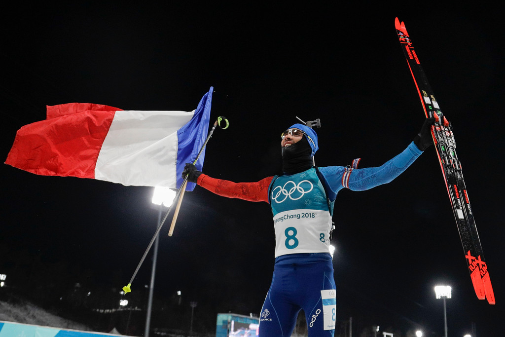 . Martin Fourcade, of France, celebrates his gold medal finish in the men\'s 12.5-kilometer biathlon pursuit at the 2018 Winter Olympics in Pyeongchang, South Korea, Monday, Feb. 12, 2018. (AP Photo/Gregorio Borgia)
