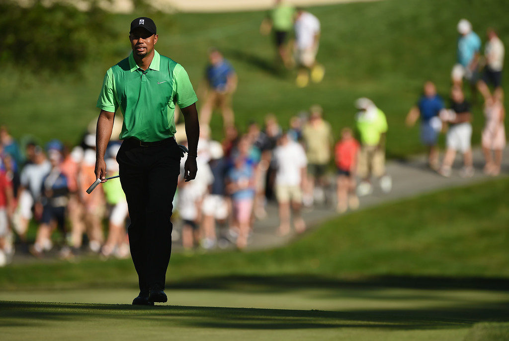 . BETHESDA, MD - JUNE 26:  Tiger Woods of the United States walks on the 13th green during a first round of the Quicken Loans National at Congressional Country Club on June 26, 2014 in Bethesda, Maryland.  (Photo by Patrick Smith/Getty Images)