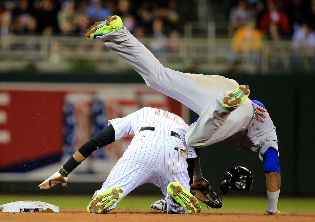 . American League All-Star Alexei Ramirez #10 of the Chicago White Sox  slides into National League All-Star Starlin Castro #13 of the Chicago Cubs at second base during the 85th MLB All-Star Game at Target Field on July 15, 2014 in Minneapolis, Minnesota.  (Photo by Rob Carr/Getty Images)