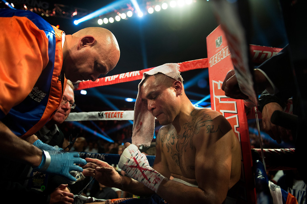 . BROOMFIELD, CO. - October 19: Cut man Rudy Hernandez takes off the wrap from Mike Alvarado\'s fists after his loss to Russian Ruslan Provodnikov after the 10th round at the 1st Bank Center October 19, 2013 Broomfield, Colorado. (Photo By Joe Amon/The Denver Post)