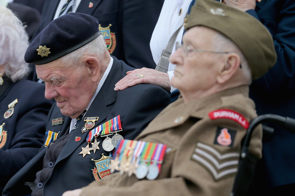 . D-Day veterans Ken Scott, aged 98, and Bob Conway 88 (L), pause for thought during the Royal Artillery Commemoration Parade and service on June 5, 2014 in Hermanville, France. (Photo by Christopher Furlong/Getty Images)