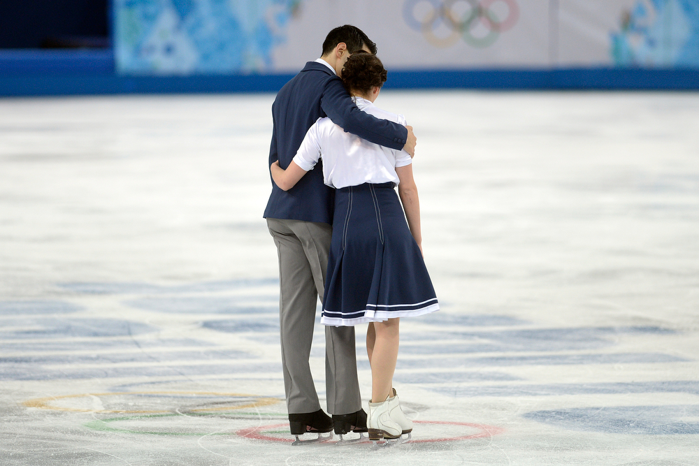 . Italy\'s Luca Lanotte and Anna Cappellini hug after scoring a 64.92 in ice dance short during team figure skating. Sochi 2014 Winter Olympics on Saturday, February 8, 2014. (Photo by AAron Ontiveroz/The Denver Post)