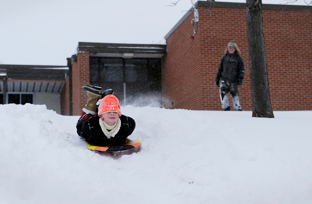 . Aidan Zerr, 8, sleds down a hill in style as his brother, Andrew Zerr, 15, watches on Feb. 24 in Littleton, Colo. Photo by Jamie Cotten, Special to The Denver Post