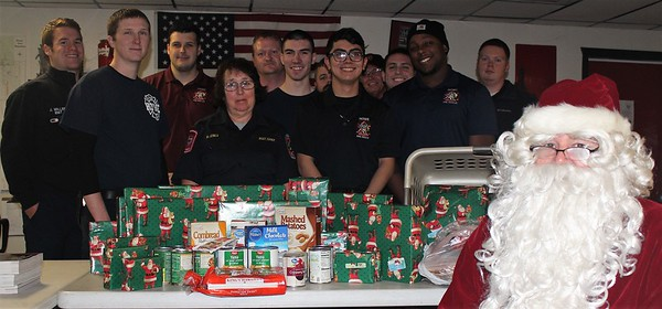 Howe Fire Department delivers presents and food to local family, 12/19/2017