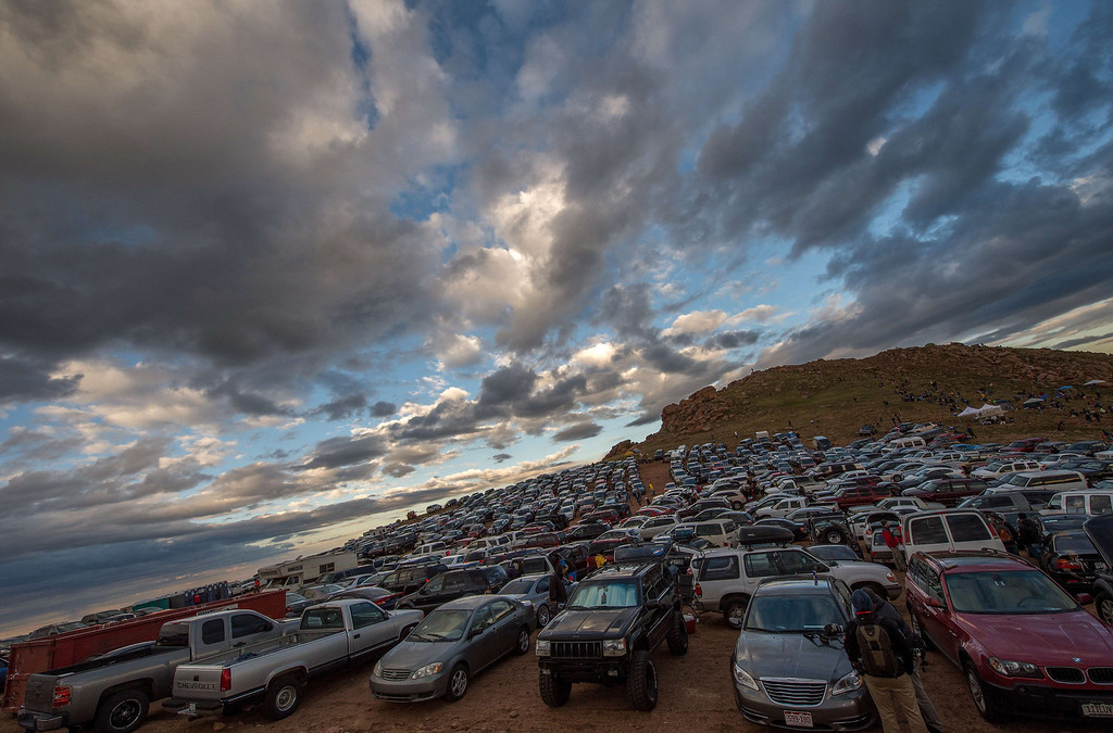 . Cars are parked near the summit of Pikes Peak mountain during the Pikes Peak International Hill Climb (PPIHC) at Pike National Forest, 10 miles (16 km) west of Colorado Springs, Colorado, on June 30, 2013. The Pikes Peak International Hill Climb (PPIHC), also known as The Race to the Clouds, an annual automobile and motorcycle hillclimb to the summit of Pikes Peak. The track measures 12.42 miles (19.99 km) over 156 turns to the finish.      JOE KLAMAR/AFP/Getty Images