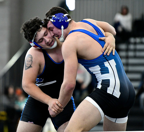 2/22/2019 Mike Orazzi | Staff Bristol Eastern's Trinidad Gonzalez and Hall High School's Hugh Wells in a 220 pound match during the CIAC State Open Wrestling Tournament at the Floyd Little Athletic Center in New Haven Saturday.