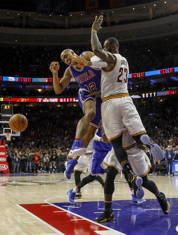 . Philadelphia 76ers\' Gerald Henderson, left, gets the ball knocked away by Cleveland Cavaliers\' LeBron James, right, during the second half of an NBA basketball game, Saturday, Nov. 5, 2016, in Philadelphia. The Cavaliers won 102-101. (AP Photo/Chris Szagola)