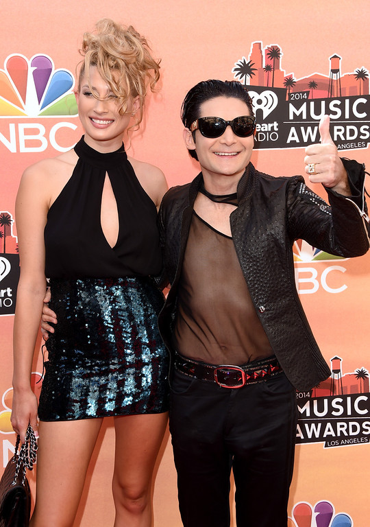 . LOS ANGELES, CA - MAY 01:  Model Courtney Anne(L) and actor Corey Feldman attend the 2014 iHeartRadio Music Awards held at The Shrine Auditorium on May 1, 2014 in Los Angeles, California. iHeartRadio Music Awards are being broadcast live on NBC.  (Photo by Jason Merritt/Getty Images for Clear Channel)