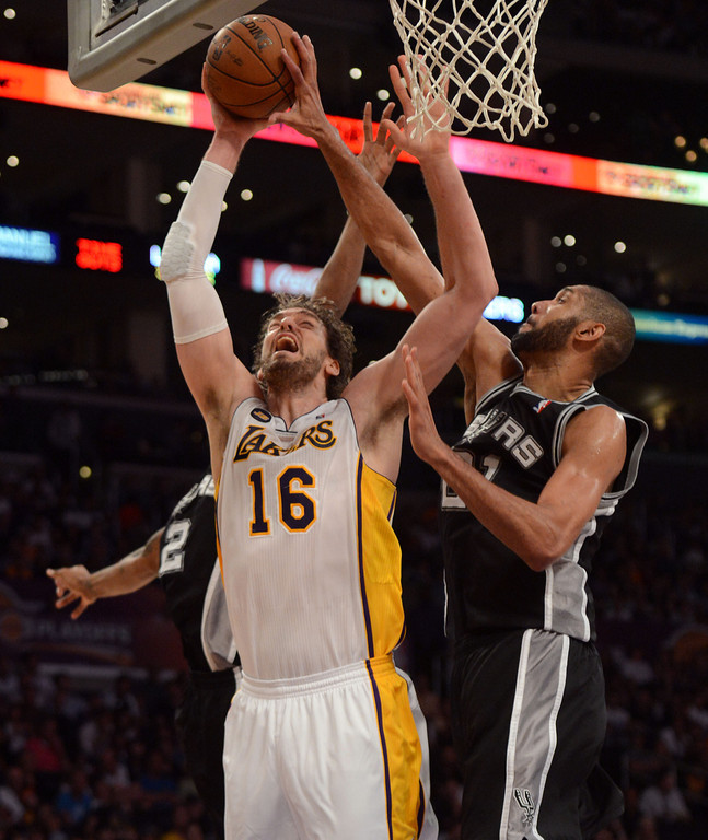. The Lakers\'  Pau Gasol #16 shoots as the Spurs\' Tim Duncan #21 defends during game four of their NBA Western Conference playoffs at the Staples Center Saturday, April 28, 2013. The Spurs beat the Lakers 120-89. The Spurs beat the Lakers 103-82. (Hans Gutknecht/Staff Photographer)