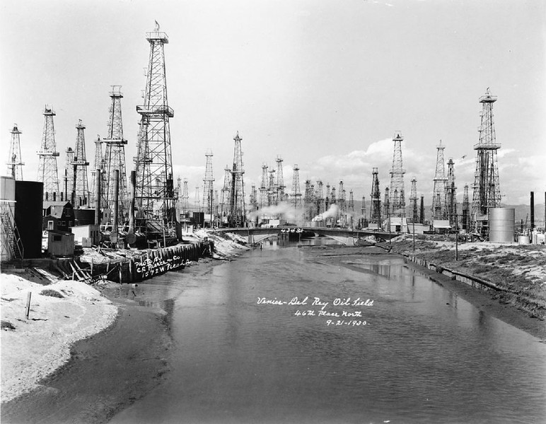 View of Venice-Del Rey Oil fields spaced along a river, September 1930