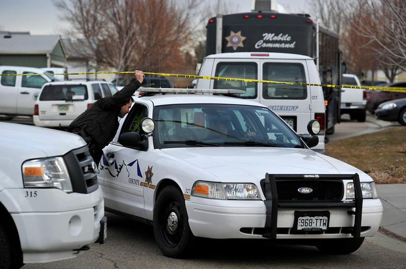 . Weld County Sheriffs deputies investigate the scene, Tuesday, Dec. 18, 2012, in Longmont. (Matthew Jonas/Times-Call)