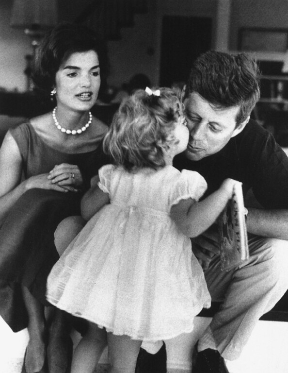 . In this photo, President John F. Kennedy and Jackie Kennedy play with their daughter Caroline Kennedy. (AP-Photo)