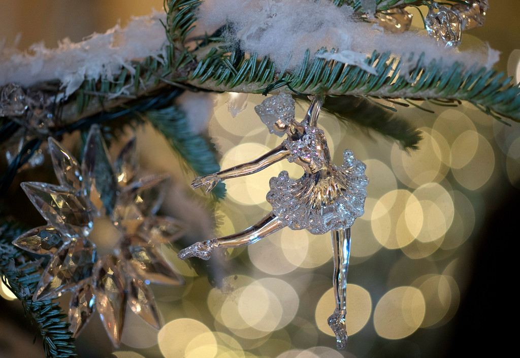 """. Tree ornaments in the Grand Foyer and Cross Hall are in \""""The Nutcracker Suite\"""" theme as seen during a media preview of the 2017 holiday decorations at the White House in Washington, Monday, Nov. 27, 2017. (AP Photo/Carolyn Kaster)"""