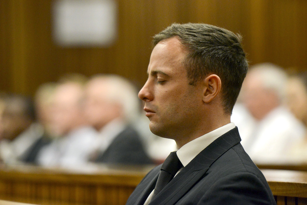 . Paralympian Oscar Pistorius is seen during his sentencing for the killing of his girlfriend Reeva Steenkamp at the high court in Pretoria, on October 21, 2014. AFP PHOTO/POOL / HERMAN VERWEY/AFP/Getty Images