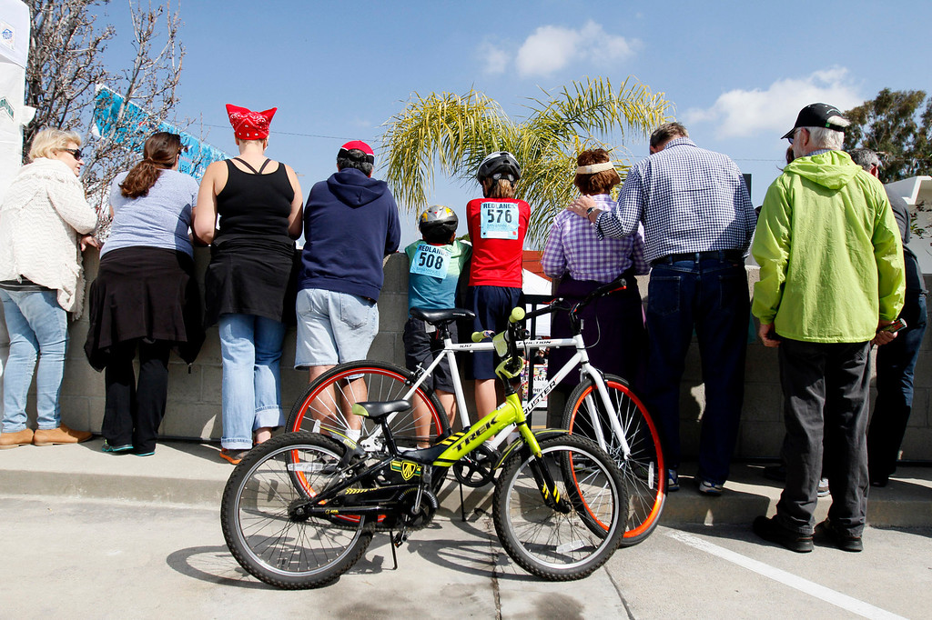. A crowd forms to watch the public race portion of the Redlands Bicycle Classic on Saturday, April 5, 2014 in Redlands, Ca. (Photo by Micah Escamilla for the Redlands Daily Facts)