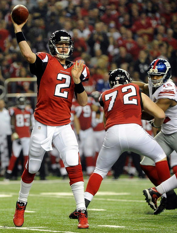 . Atlanta Falcons quarterback Matt Ryan (2) works against the New York Giants during the first half of an NFL football game on Sunday, Dec. 16, 2012, in Atlanta. (AP Photo/John Amis)