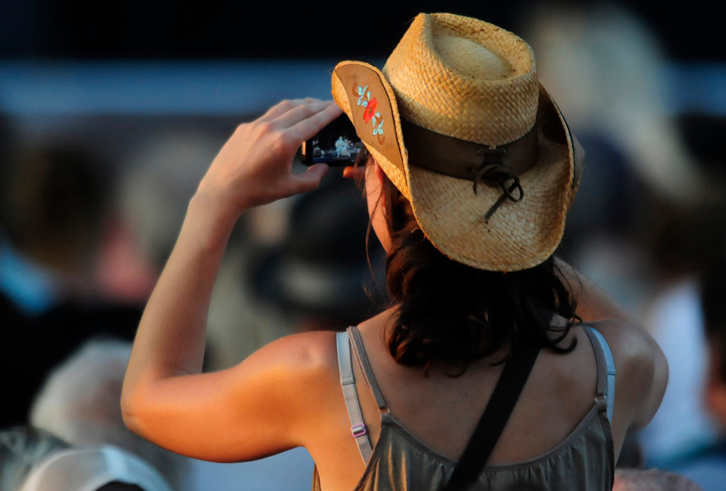 . A fan photographs as Dwight Yoakam performs at the Minnesota State Fair Grandstand. (Pioneer Press: Scott Takushi)
