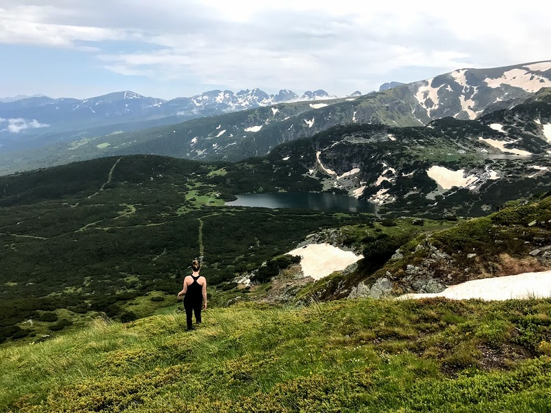 woman hiking in green-covered mountains