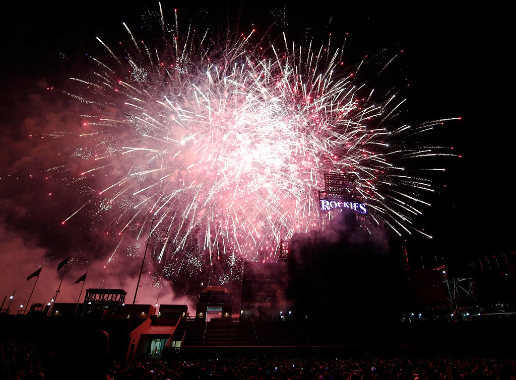 . Fireworks explode over the scoreboard in Coors Field during to mark the Independence Day holiday after a baseball game between the San Francisco Giants and Colorado Rockies on Wednesday, July 4, 2018, in Denver. The Rockies won 1-0. (AP Photo/David Zalubowski)