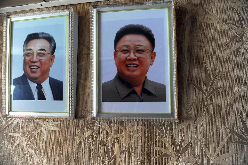 . Portraits of late North Korean leaders Kim il-Sung(L)  and Kim Jong-il are seen inside of North Korean vessel Chong Chong Gang at  Manzanillo harbour in Colon, 90km from Panama City on July 16, 2013.  AFP PHOTO / Rodrigo  ARANGUA/AFP/Getty Images
