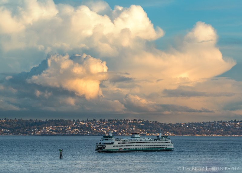 Dramatic clouds at sunset this evening, as the ferry enters the harbor.