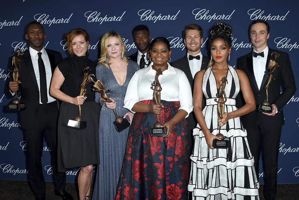 ". The cast of ""Hidden Figures\"" pose backstage with the ensemble performance award at the 28th annual Palm Springs International Film Festival Awards Gala on Monday, Jan. 2, 2017, in Palm Springs, Calif. From left are Mahershala Ali, Kimberly Quinn, Kirsten Dunst, Aldis Hodge, Octavia Spencer, Glen Powell, Janelle Monae and Jim Parsons. (Photo by Jordan Strauss/Invision/AP)"