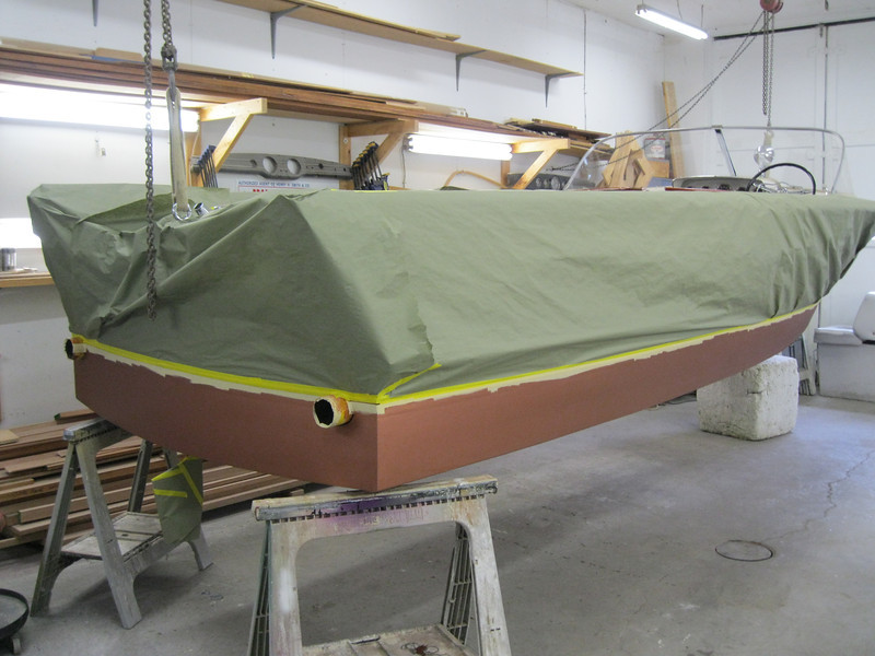 Rear starboard view of bottom being painted.