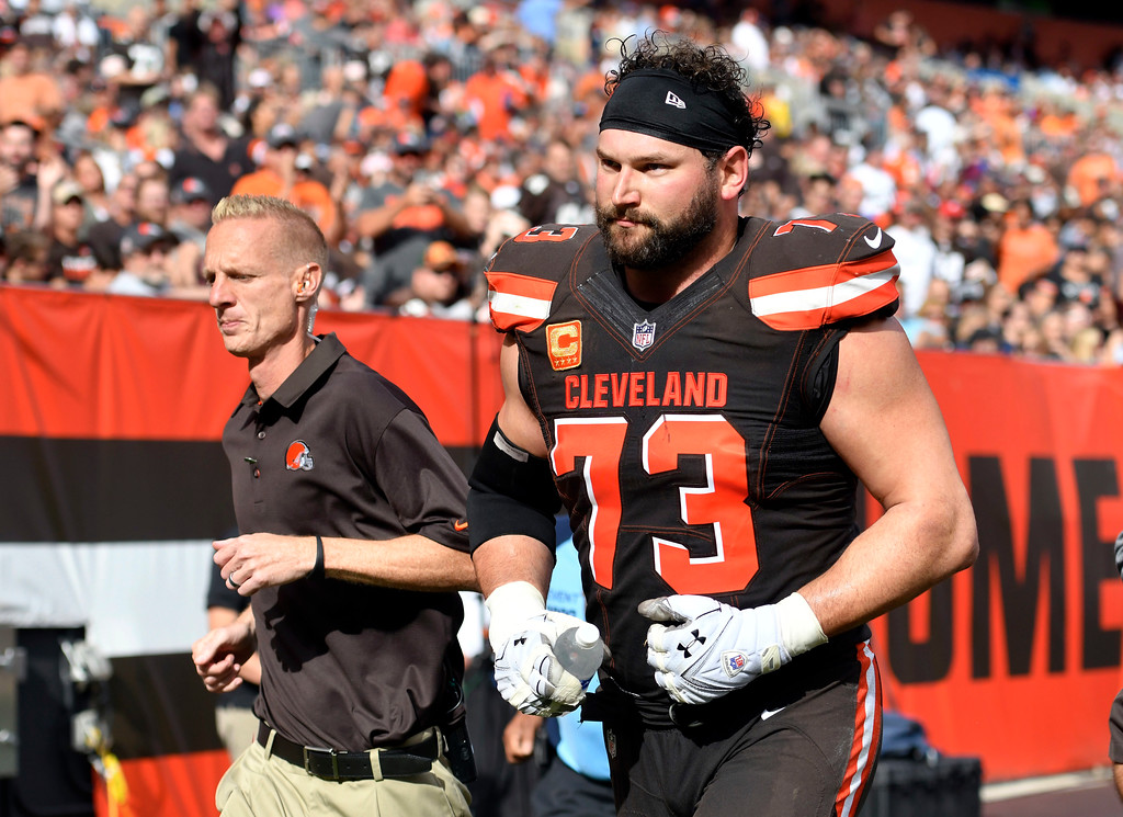 . Cleveland Browns tackle Joe Thomas (73) leaves the field with a trainer after getting hurt in the second half of an NFL football game against the Tennessee Titans, Sunday, Oct. 22, 2017, in Cleveland. (AP Photo/David Richard)
