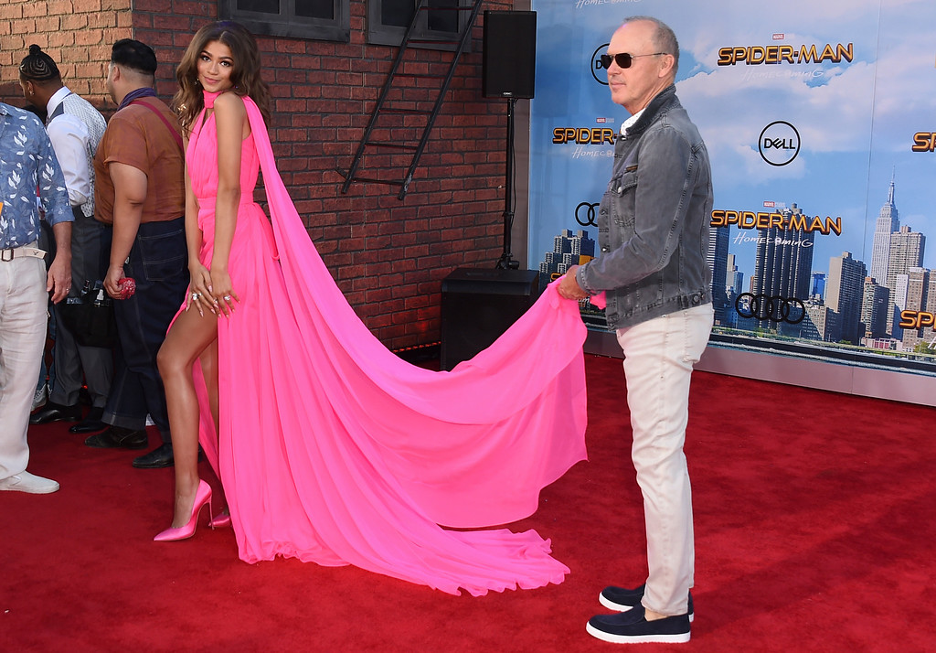 """. Michael Keaton holds Zendaya\'s dress as they arrive at the Los Angeles premiere of \""""Spider-Man: Homecoming\"""" at the TCL Chinese Theatre on Wednesday, June 28, 2017. (Photo by Jordan Strauss/Invision/AP)"""