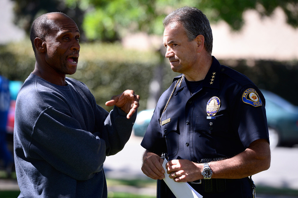 . Pasadena Police Chief Phillip Sanchez talks to a man as Pasadena Police investigate an officer involved shooting at Kings Village in Pasadena Friday, October 11, 2013. (Photo by Sarah Reingewirtz/Pasadena-Star News)