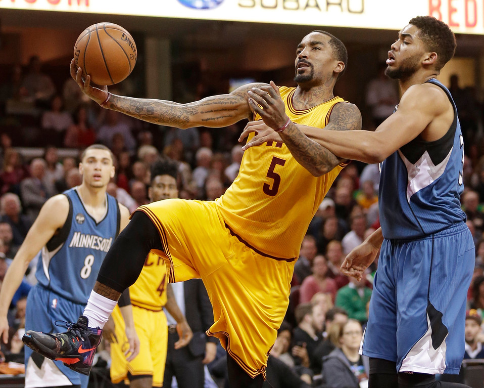 . Minnesota Timberwolves\' Karl-Anthony Towns, right, fouls Cleveland Cavaliers\' J.R. Smith in the first half of an NBA basketball game Monday, Jan. 25, 2016, in Cleveland. (AP Photo/Tony Dejak)