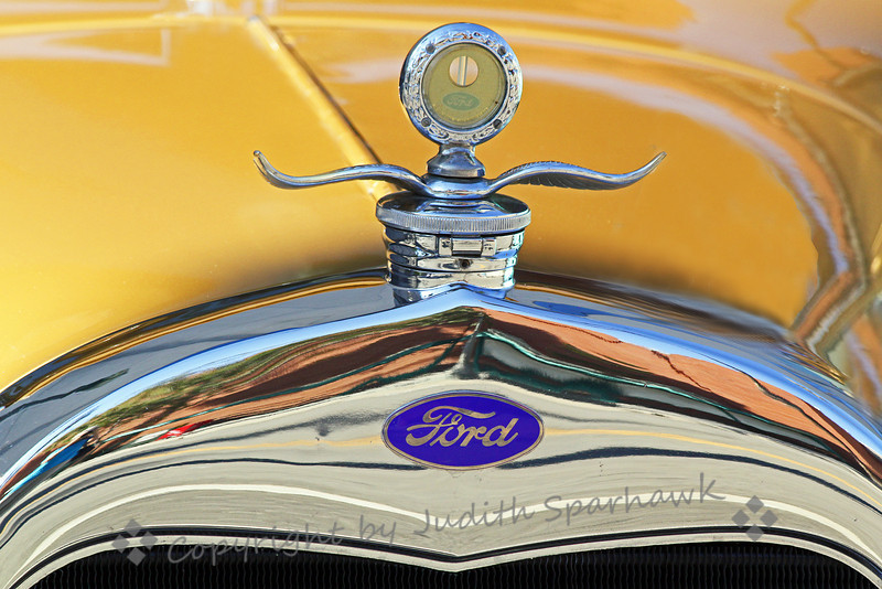 Ford Hood Ornament ~ This yellow Ford was on display at the Route 66 Rendezvous celebration in San Bernardino, California.  This is an annual event, and this year was the 23rd year.  After seeing this one on the computer, I saw that I was reflected on the left side of the chrome.