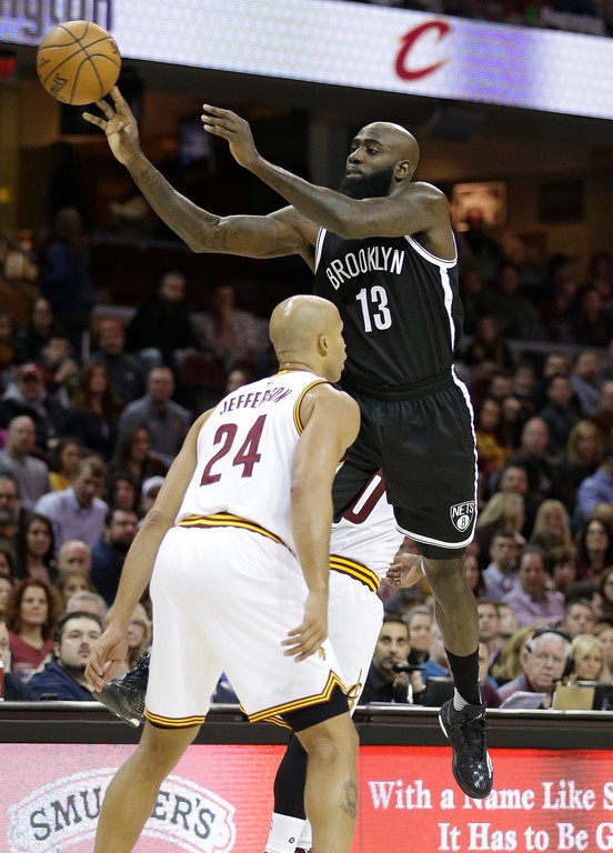 . Brooklyn Nets\' Quincy Acy (13) shoots against Cleveland Cavaliers\' Richard Jefferson (24) in the first half of an NBA basketball game, Friday, Jan. 27, 2017, in Cleveland. (AP Photo/Tony Dejak)