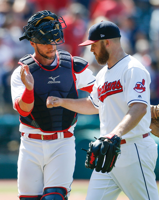 . Cleveland Indians\' Yan Gomes, left, and Cody Allen celebrate a 5-2 victory over the New York Yankees in a baseball game, Sunday, July 15, 2018, in Cleveland. (AP Photo/Ron Schwane)