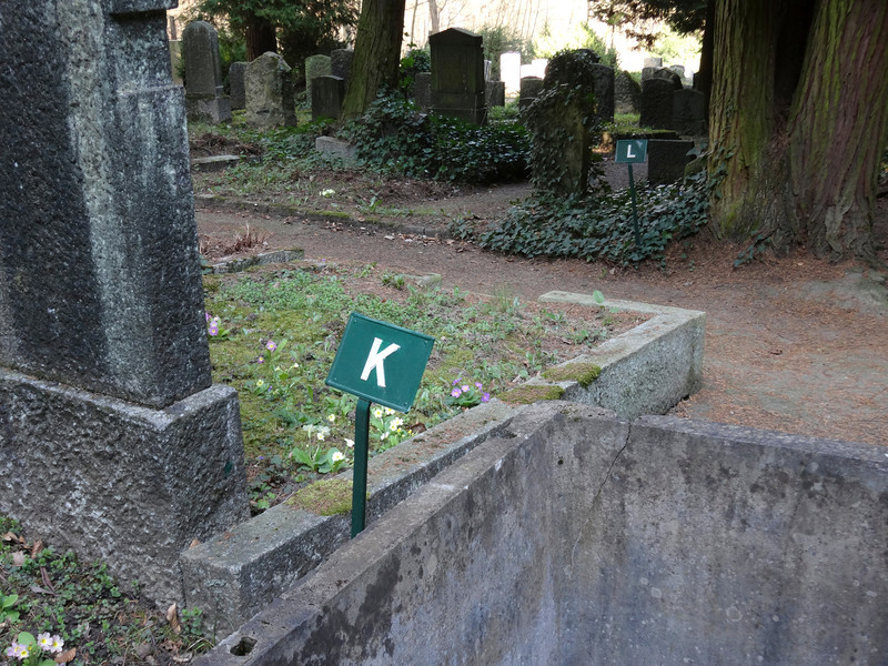 His grave can be found in row k