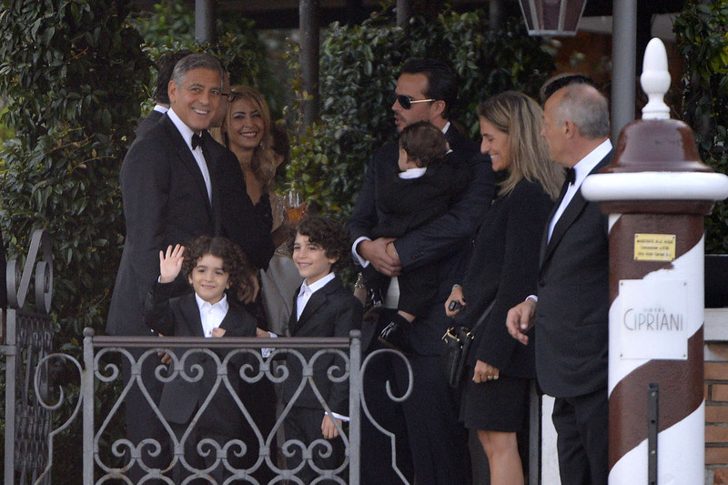 """. US actor George Clooney (L) speaks with guests before to leave the Cipriani hotel on September 27, 2014 in Venice where Clooney and British fiancee, Amal Alamuddin celebrate their wedding. George Clooney has said goodbye to bachelorhood in Venice with a stag party at his favourite restaurant with Hollywood chums, and was gearing up for a day of glamorous pre-wedding celebrations. The actor had swept into the floating city yesterday with his British fiancee Amal Alamuddin on a watertaxi dubbed \""""Amore\"""", zipping up the Grand Canal to cheers from fans at the start of nuptials set to draw out over the weekend.    ANDREAS SOLARO/AFP/Getty Images"""
