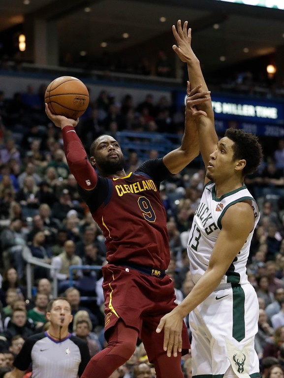 . Cleveland Cavaliers\' Dwyane Wade shoots over Milwaukee Bucks\' Malcolm Brogdon during the first half of an NBA basketball game Tuesday, Dec. 19, 2017, in Milwaukee. (AP Photo/Morry Gash)
