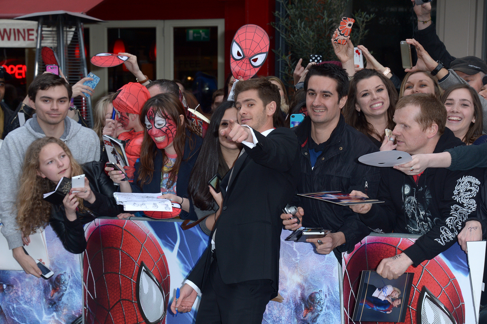 . British actor Andrew Garfield poses for photos and signs autographs for fans as he arrives on the red carpet for the world premiere of The Amazing Spider-Man 2 in Leicester Square, London, Thursday April 10, 2014. (Photo by Jon Furniss/Invision/AP)
