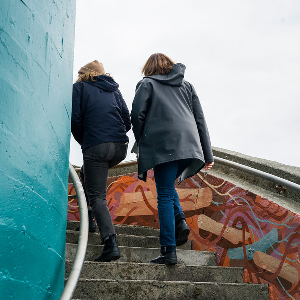 Two women walking up staircase, Spiral Beach, Victoria, British Columbia, Canada